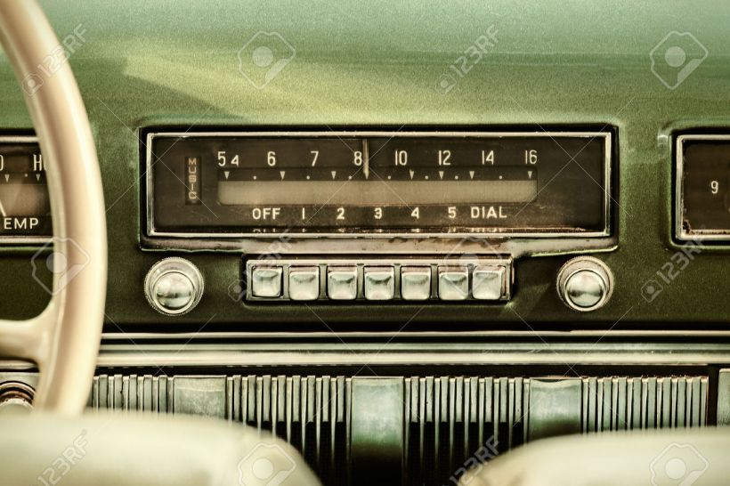 39022638-Retro-styled-image-of-an-old-car-radio-inside-a-green-classic-car-Stock-Photo
